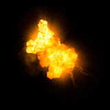 Realistic fiery explosion. With sparks over a black background Royalty Free Stock Images