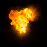 Realistic fiery explosion. With sparks over a black background Royalty Free Stock Image