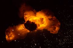 Fireball: explosion, detonation. Realistic fiery explosion with sparks over a black background Royalty Free Stock Image