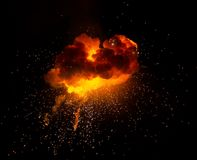 Fireball: explosion, detonation. Realistic fiery explosion with sparks over a black background Stock Photography
