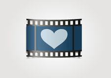 Realistic film reel on blue background Stock Images