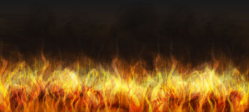 Realistic fire on a dark background. Stock Photos