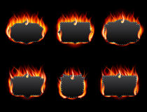 Realistic Fire Label Set on Dark Background Stock Images