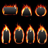 Realistic Fire Label Set on Dark Background Royalty Free Stock Images