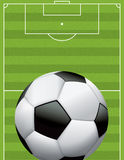 Realistic Football - Soccer Ball on Textured Field. A realistic football - soccer ball on a textured grass playing field. Vector EPS 10 file available. EPS file royalty free illustration