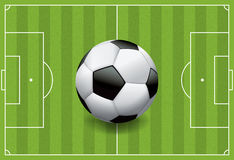 Realistic Football - Soccer Ball on Textured Field. A realistic football / soccer ball on a textured grass playing field. Vector EPS 10. File contains royalty free illustration