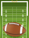 Realistic Football on Textured Football Field. A football sitting on a grass textured football field. Vector EPS 10 file available. EPS file contains stock illustration