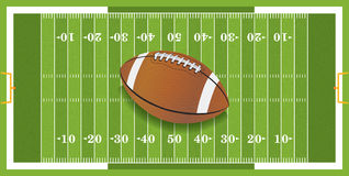 Realistic Football on Textured Football Field Royalty Free Stock Photo