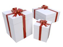 Realistic gift boxes in white with red and gold bow Royalty Free Stock Photography