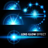 Realistic glare and rays bright flash of blue light on a dark background. Set the template for web design. vector. Illustration Stock Image