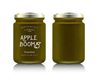 Realistic glass bottle packaging. For fruit jam design. Apricot jam with design label, typography, line drawing apricots i. Mock up container or jar Royalty Free Stock Photo