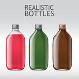 Realistic glass bottles empty transparent set. Set of different empty glass bottles. Template for design of bottles of milk, juice, yogurt, vinegar and any other Stock Images