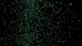 Realistic Glitter Exploding on Black Background. With the use of Realistic Glitter Exploding on Black Background. These clips are perfect for visual effects stock video footage