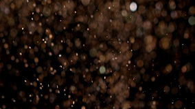 Realistic Glitter Exploding on Black Background. With the use of Realistic Glitter Exploding on Black Background. These clips are perfect for visual effects stock footage