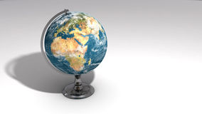 A realistic globe on a chrome pedestal over white C Stock Images