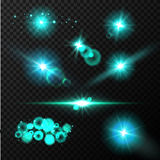 Realistic glow blue light effects. Lens flare set. Realistic glowing sparkles particles effects on dark transparent grid Stock Photo