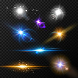 Realistic glow light effects. Lens flare set. Realistic glowing sparkles particles effects on dark transparent grid Stock Image