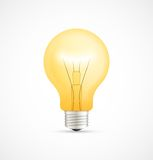 Realistic glowing yellow light bulb Stock Photography