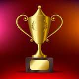 Realistic Gold cup for first place On a red background. Vector illustration Stock Image