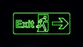 Realistic Green Neon Exit Sign in Neon Style Turning On