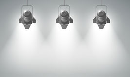 Realistic Hanging Spotlights Composition. With three bright beams in empty space on grey background vector illustration Stock Image