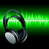 Realistic Headphones digital Equalizer sound wave background. Realistic Headphones digital music Equalizer green sound wave background Royalty Free Stock Image