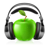 Realistic headphones and green apple Stock Images