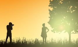 Realistic illustration silhouettes photographer men and women models in the landscape with forest, tree and grass under yellow vector illustration