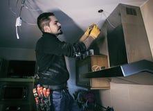 Juancho repairing electricity at hme royalty free stock photos