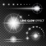 Realistic lens flares and rays flash white light on a dark background. Vector illustrations. Realistic lens flares and rays flash white orange light on a dark Stock Image