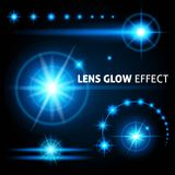 Realistic lens flares and rays flash white orange light on a dark background. Set the template for web design. Illustrations Stock Image