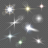 Realistic lens flares star lights and glow white elements on transparent background vector illustration.  Stock Photography