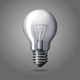 Realistic light bulb isolated on grey background. Royalty Free Stock Photo