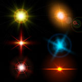 Realistic light glare sparkle, highlight set. Collection of beautiful bright lens flares. Lighting effects of flash. Royalty Free Stock Image