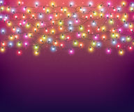 Realistic luminous bulbs for festive decoration. Colourful glowing Christmas garland. Fairy lights for festive decoration, realistic luminous bulbs. Colourful Stock Photo