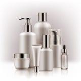 Realistic luxury premium brand set of cosmetic bottles, mockup, 3D. Realistic luxury gamorous set of cosmetic bottles in silver and white on white background Stock Photography