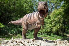 Realistic model of dinosaur Tyrannosaurus Rex. BRATISLAVA, SLOVAKIA - JUN 28: Realistic model of dinosaur Tyrannosaurus Rex at Dinopark on Jun 28, 2014 in Stock Photo