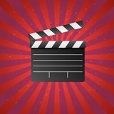Realistic movie and film clapperboard icon on red background with sun rays and stars. Art design cinema slate board template. vector illustration
