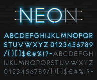 Realistic neon alphabet on a background of black brick wall. Blue glowing font. Vector format