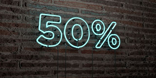 50% -Realistic Neon Sign on Brick Wall background - 3D rendered royalty free stock image Royalty Free Stock Photography
