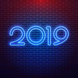 Realistic neon sign of 2019 logo for decoration on the wall background. Concept of Merry Christmas and Happy New Year. vector illustration