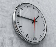 Realistic Office Clock. Close Up of Realistic Office Clock on Concrete Wall with Black anf Red Hands, Classic Clock Face with Focus on Center, Round Clock Royalty Free Stock Photo
