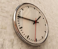 Realistic Office Clock. Close Up of Realistic Office Clock on Concrete Wall with Black anf Red Hands, Classic Clock Face with Focus on Center, Round Clock Stock Photo