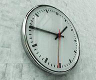 Realistic Office Clock. Close Up of Realistic Office Clock on Concrete Wall with Black anf Red Hands, Classic Clock Face with Focus on Center, Round Clock Royalty Free Stock Photography
