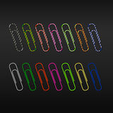 Realistic paper clips on a dark background Stock Photos