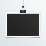 Realistic photo frame mockup. Retro photo frame mockup. White plastic border hanging on a clip on a light background. Realistic detailed Photo icon design Royalty Free Stock Images