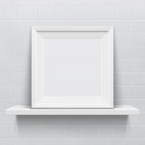 Realistic picture frame on white realistic shelf Royalty Free Stock Images