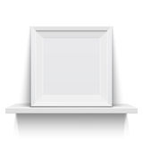 Realistic picture frame on white realistic shelf Royalty Free Stock Photography