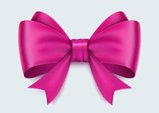 Realistic pink bow isolated on white background. Royalty Free Stock Photo