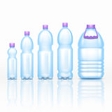 Realistic plastic drink bottles mockups isolated on white background vector set Royalty Free Stock Image